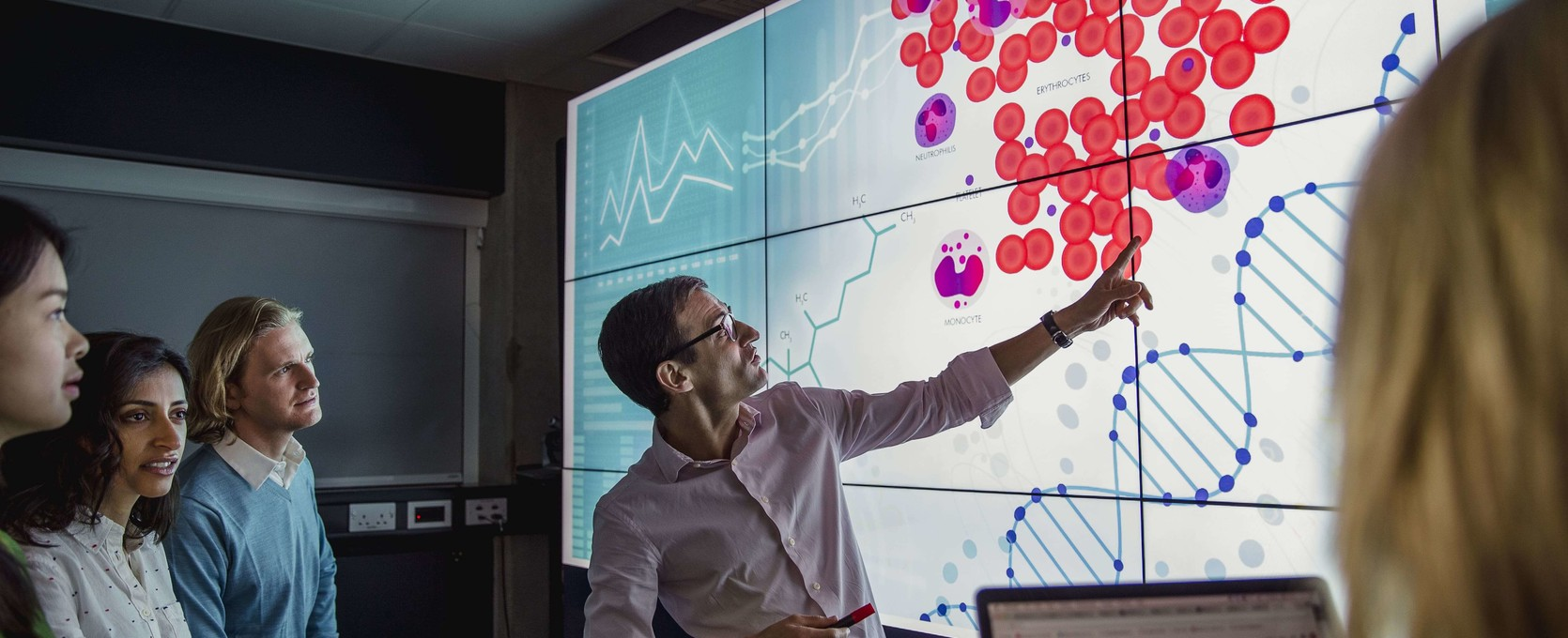 Healthcare professionals reviewing life sciences data dashboard