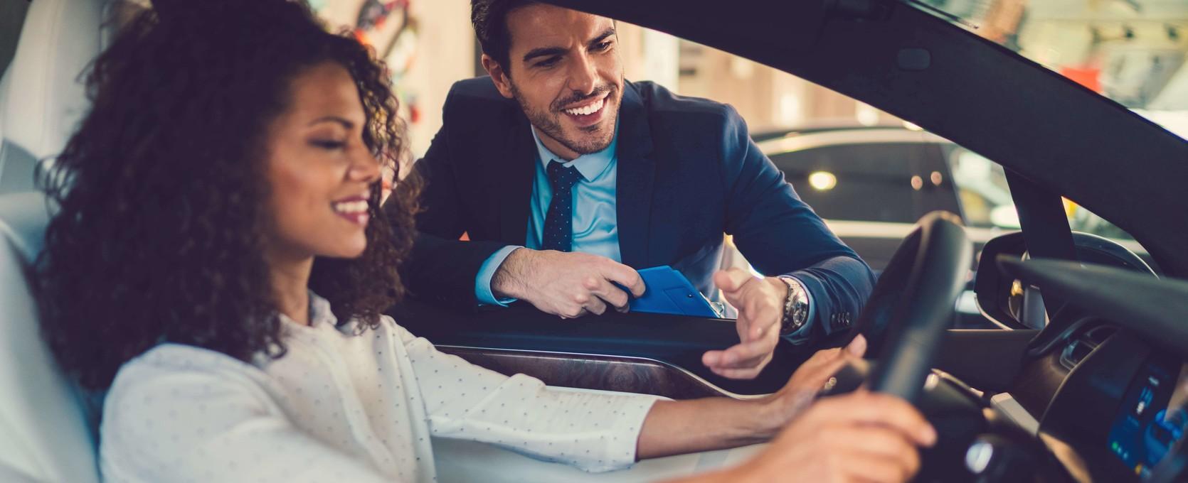 Happy customer at an automotive dealership