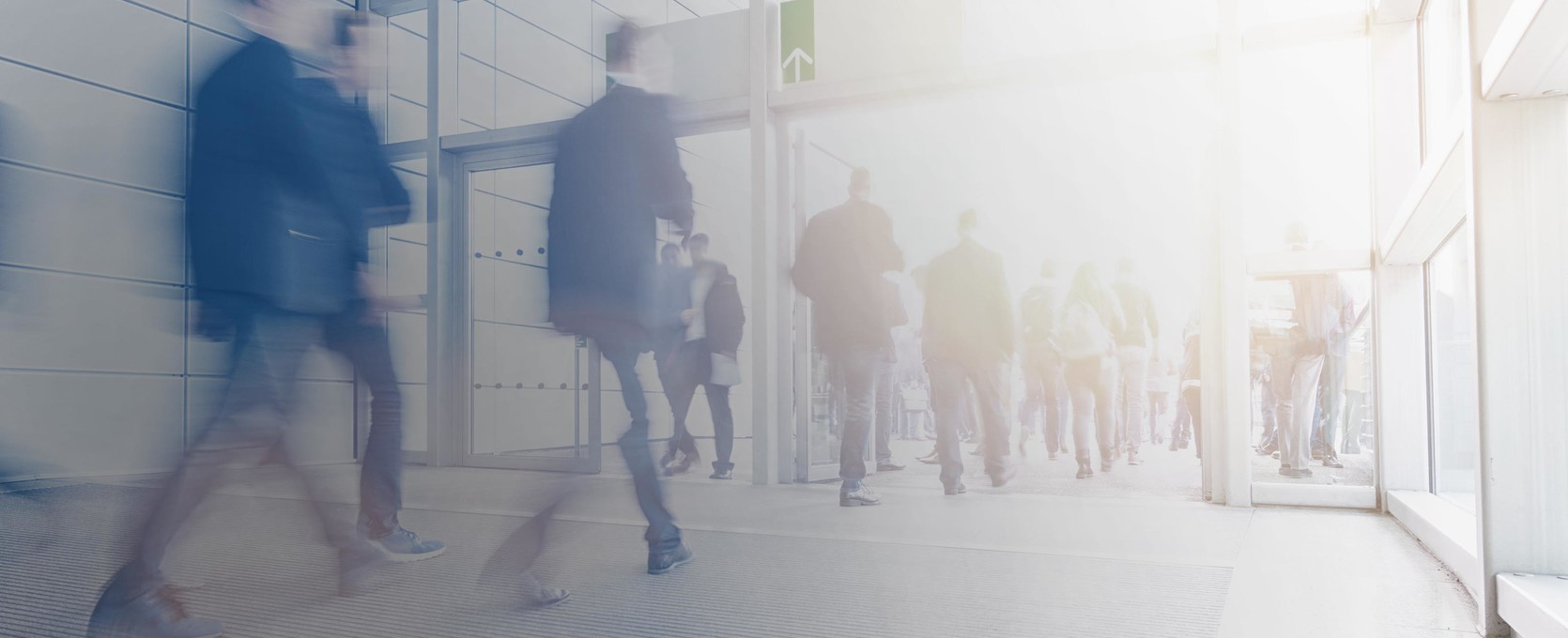 Business professionals entering and exiting building